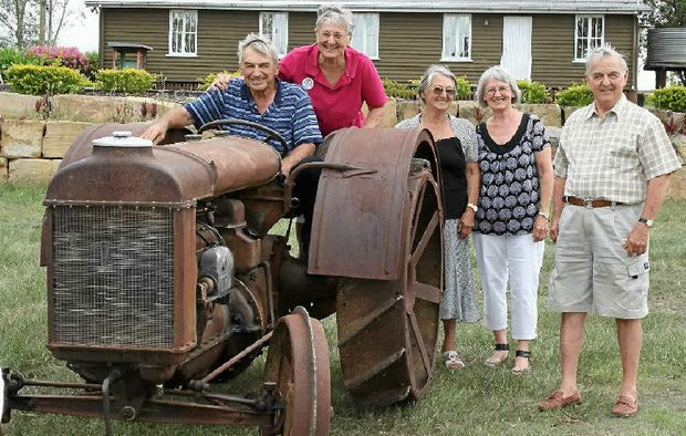 FAMILY HERITAGE: Cecil Logan, Pam Logan, June Schulz, Lynette Mackenzie and Peter Logan are ecstatic to see the family's tractor alive and working again.