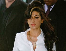 Amy Winehouse was 'crying for help', director claims