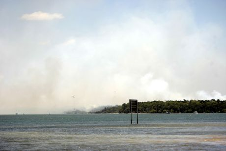 White Patch Fire on Bribie Island with helicopters bombing. Photo Vicki Wood / Caboolture News