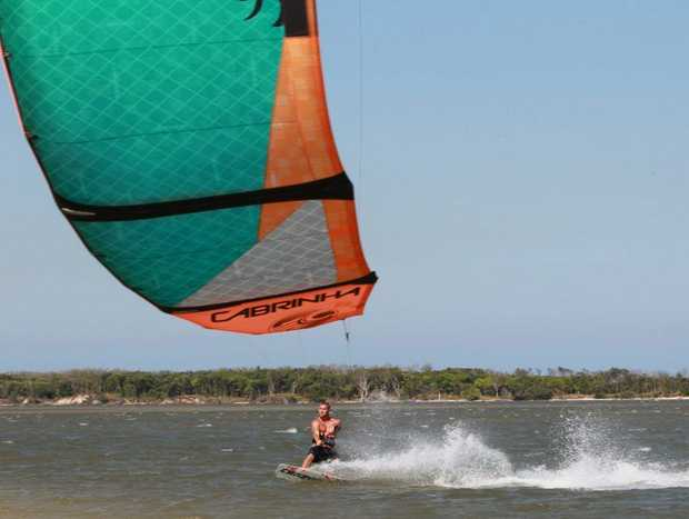 Strong winds brought out the windsurfers and kite surfers in the Pumicestone Passage at Golden Beach. Bruce McCaul got amongst it.