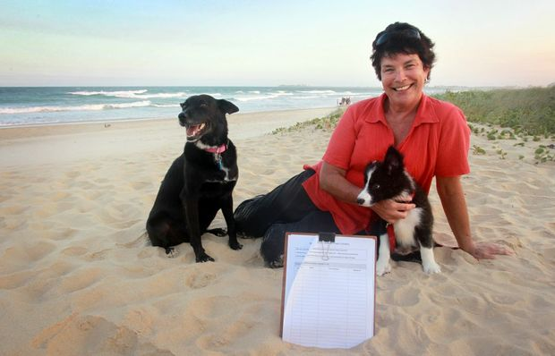 Natasza Baillie with Sasha and Piper at Maroochydore North Shore Beach. Natasza has organised a petition urging council not to close the offleash dog area.