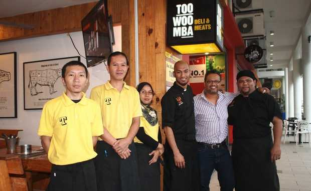Nordin Mat of Kuala Lumpur (second from right) has opened a deli and meat in Malaysia called 'Toowoomba'.