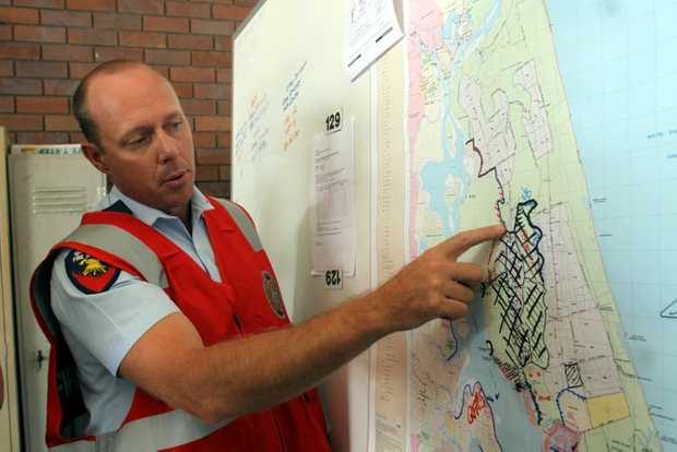 Division commander inspector Paul Durston looks over a map of Bribie. Photo Vicki Wood / Caboolture News