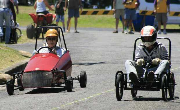 Denis Seal and Miles Nagle compete in the annual Australia Day Maclean Billycart Derby in 2011. Photo: Rodney Stevens