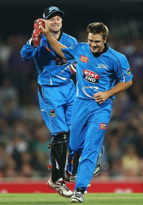 Cameron Boyce (R) and Tim Ludeman of the Strikers celebrate taking the wicket of Ricky Ponting of the Hurricanes during the BBL match between the Hobart Hurricanes and the Adelaide Strikers at Blundstone Arena on January 5, 2013 in Hobart, Australia.