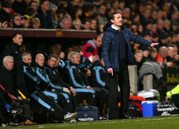 Phil Parkinson the manager of Bradford City gives instructions to his players during the Capital One Cup Semi-Final 1st Leg match between Bradford City and Aston Villa at Coral Windows Stadium on January 8, 2013 in Bradford, England.