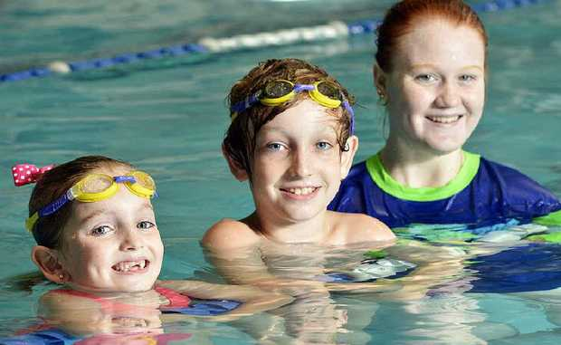 TESTING THE WATER: Lilly and Linkin Halliday with trainee swim instructor Dionne Buckley at McMahon's Swim Factory.