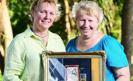 FLOOD TALE: Artist Deb Mostert (left) tells the story of exhibition participant Margaret Kloostra, from Goodna.