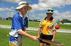 Ethan Morris shows his style with the vigoro bat to his sister Felicity at Harrup Park before playing for Townsville in the junior final.