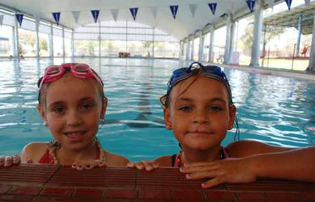 Heidi Dodd and Lilly Fraser spent the hottest part of the day today cooling off in the Roma pool.