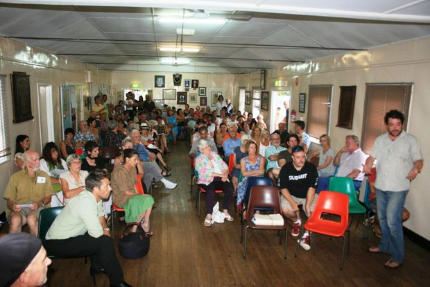 PROJECT STATION ST: Josh Rogers, far right, of the Bangalow school P&C;, addresses a meeting of local residents seeking to learn more about a proposed development in the town.