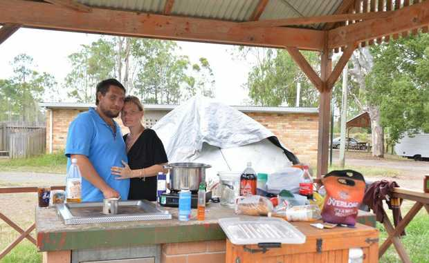 Rob Morris and Rhiannon Thompson have been ordered from their illegal campsite at Gympie's Six Mile Creek rest area.