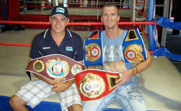 Brendon Smith (left) and boxer Les Sherrington with some of the spoils of their successful 2012 partnership.