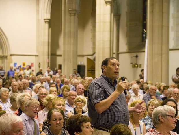 Toowoomba businessman Philip Collins asks a question at the lights on the range public meeting at St Luke's Anglican Church, Friday, January 11, 2013. Photo Kevin Farmer / The Chronicle