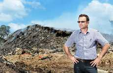HEAP OF TROUBLE: Lantrak CEO Gary Liemant at the Swanbank site where a pile of rubbish is still smouldering.