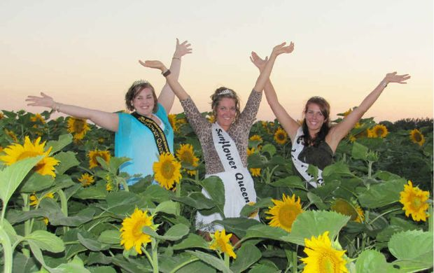 SMILING FACES: Sunflower Queen 2012 Melanie McMaster rejoices with the Canadian Sunflower Queen and Sunflower Princess.