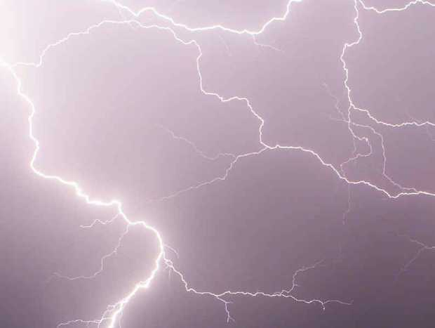 Lightning cracks across the Warwick sky during Wednesday night's 'dry' storm. Fears are held over the fire risk posed by lightning strikes.