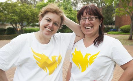 PROUD STUDENT: Mundubbera local Jennifer Dale poses for a photo in the new Phoenix t-shirts with USQ Vice-Chancellor Professor Jan Thomas. Photo: Contributed