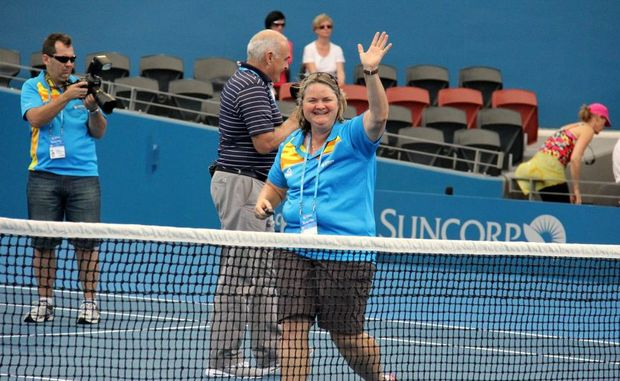VOLUNTEER AWARD: Lyn Brook waves to her friends after being recognised as a volunteer at the Brisbane International Tennis for the past five years.