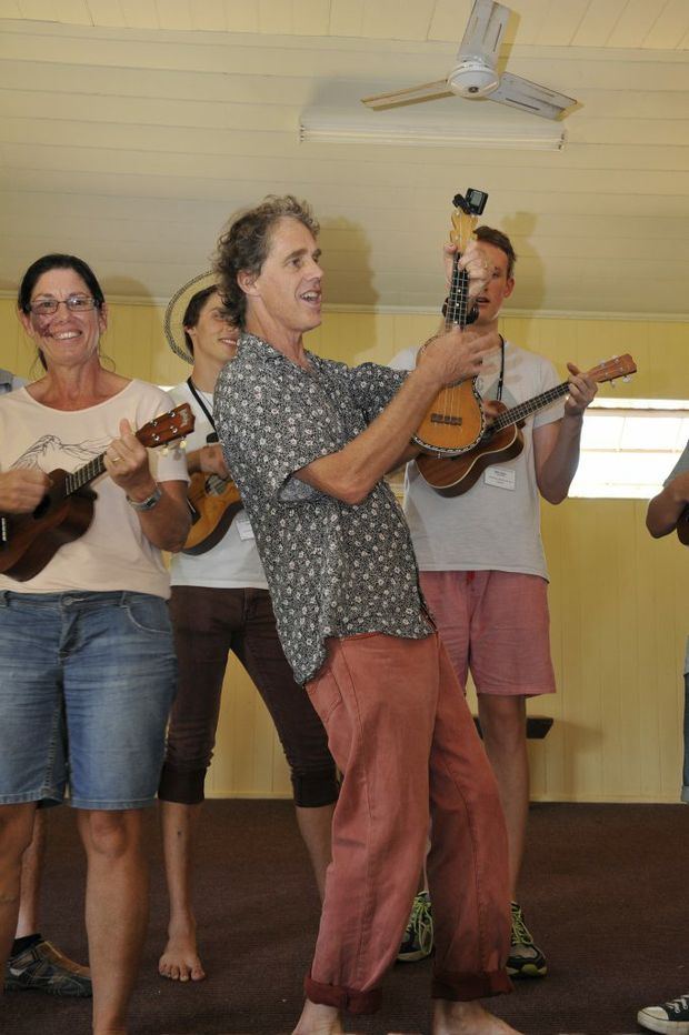 Roo Friend leads a ukulele and harmony singing workshop on the first day of the McGregor Summer School.