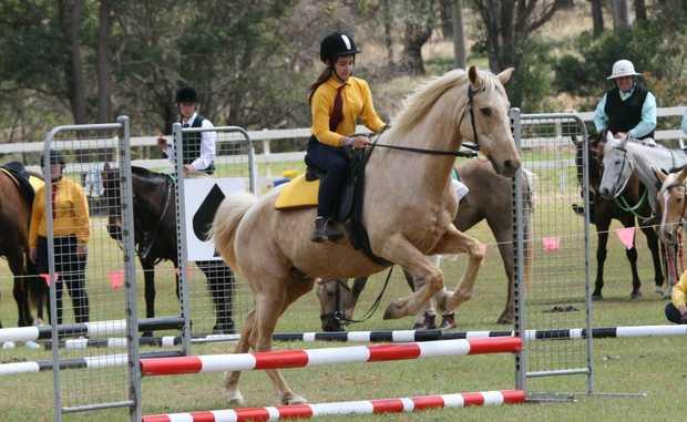 GREAT JUMP: Kumbia Pony Club's Naomi Baldacchino clears the jump.