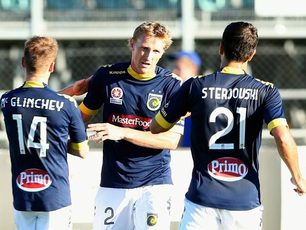 Daniel McBreen #2 of the Mariners celebrates with Michael McGlinchey and Mile Sterjovski after he scored his penalty during the round 16 A-League match between the Melbourne Victory and the Central Coast Mariners at Aurora Stadium on January 12, 2013 in Launceston, Australia.