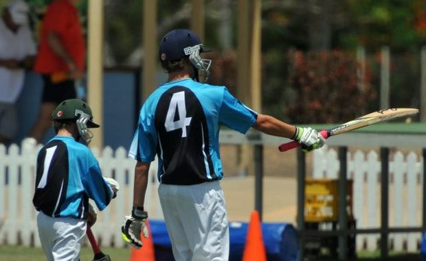 JUNIOR CRICKET: Brady Thompson and Jaye Smith leave the field in the invitational match at Salter Oval. Photo: Ben Turnbull / NewsMail