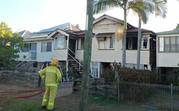 A firefigher outside a house fire on Denison Street. Photo Frazer Pearce / The Morning Bulletin