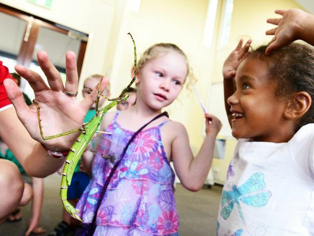 Katie Davis (left), 6, of Churchill and Alissa Brodie, 5, of Augustine Heights participate in a workshop for kids exploring the world of insects at the Environmental Education Centre in Queens Park.