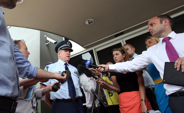 Superintendent Noel Powers addresses the media outside Logan Central Police Station.