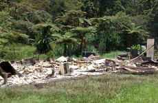 A pile of rubble and asbestos is all that remains of the Eungella house.