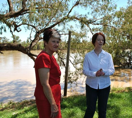 """FLOOD FACTS: Balonne Shire Council mayor Donna Stewart, pictured inspecting the swollen Balonne River with Prime Minister Julia Gillard in 2012, says the council has to get the facts about a permanent levee """"on paper"""" before information can be released"""