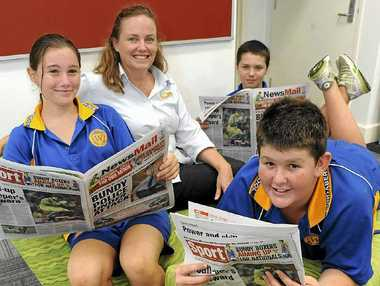 Stacey Muir, Newspapers in Education editor Robyn Courtney, (back) Dakota Biggs and (front) James Watson learn more about newspapers.