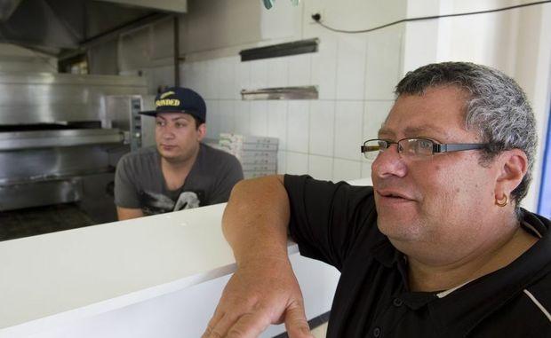 Malla and Sons Pizza and Pasta owner Giovanni (right) and his son Joshua Mallamaci.