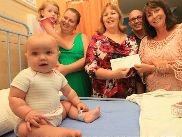 Lisa Tyler with daughter Jemma, Ann Schefe(Director of Nursing), Trevor Shearn and Leone Crayden with recovering baby Layla Fairchild(front). Photo Blainey Woodham / Daily News