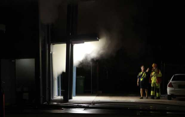 Fire at Dunckers Pool Supplies in Nambour. Barry Reynolds talks to a fireman.