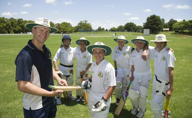 TGS director of cricket Nathan Stains gives Josh Eiser some bat pointers with at back (left to right) Baxter Farquharson, Max Mason, Fraser Stewart, Tyler Gilmore and Thomas Pearce looking on.
