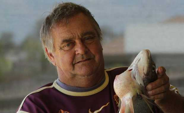 Eli Waters resident Kerry Foster caught a big bream in the canal outside his home but he won't eat it because of a bulging growth near the gills.