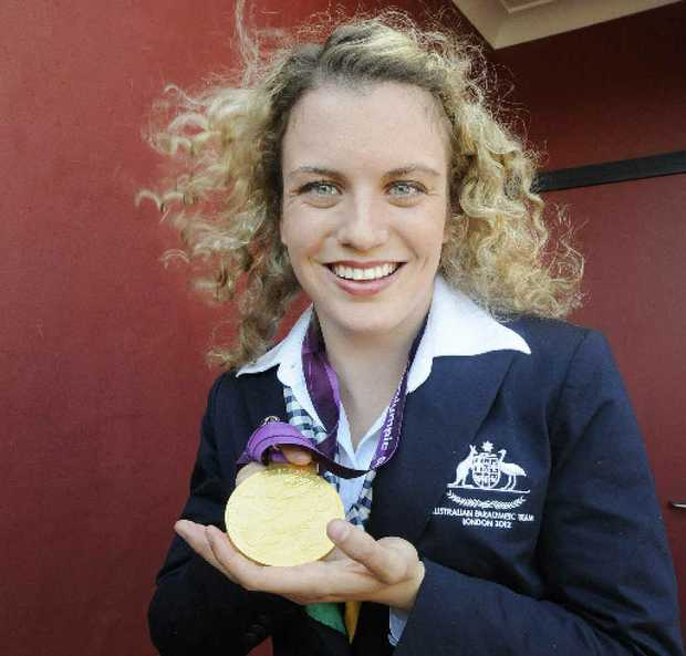 Paralympian Jacqueline Freney shows one of her medals.