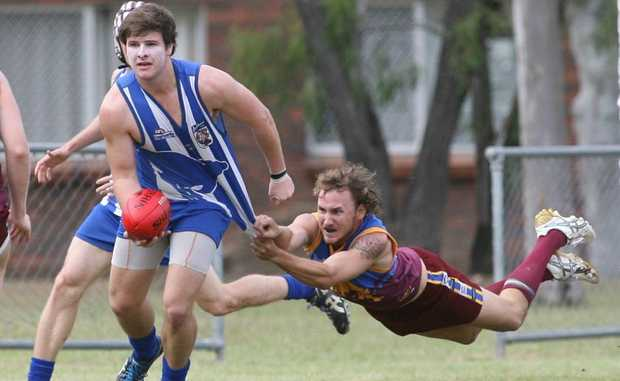 Brothers Matthew Pollock and Glenmore Brad Jenkinson in the AFL game at Stenlake Park. Photo Chris Ison / The Morning Bulletin.