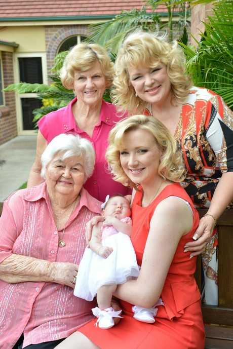 Beryl Hoolihan and Karyn de Vere (at rear) with Iris Atkinson and Emma Novak holding baby Amelia Novak.