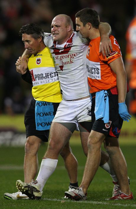 Michael Weyman of the Dragons is helped from the field with an injury during the round 10 NRL match between the Penrith Panth