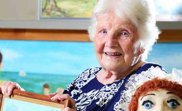 ADDS COLOUR: Nowlanvil Aged Care resident artist Iris Wilson celebrates her 100th birthday.