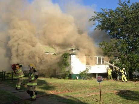 Firefighters battle to contain a fire in an abandoned house in James St. Photo contributed by Fred Daniels.