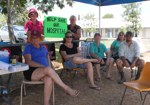 Trev Evans (centre, in green shirt) sits with other protestors today outside the Moura Hospital.
