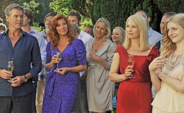 DANISH DELIGHT: Pierce Brosnan, Trine Dyrholm (red dress) and Molly Blixt Egelind in a scene from the movie Love Is All You Need.