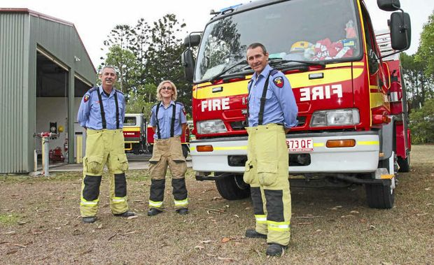 FEELING THE HEAT: Mooloolah station captain Trevor Stewart, pictured with auxiliary firefighters Daryl Aberley and Peter Allerdyce, is looking for more help to combat the high fire danger in the region.