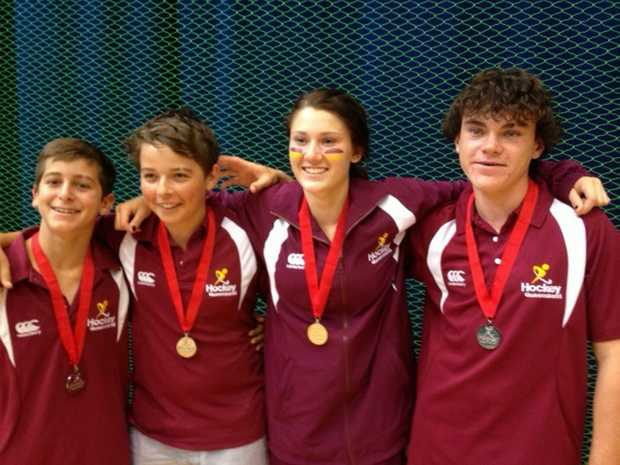Bundaberg's Ben Edwards and Maryborough trio Keelan Goodall, Jess Switzer and Jack Tucker produly show off their silver medals they won at the Australian under-15 indoor hockey championships in Tasmania.