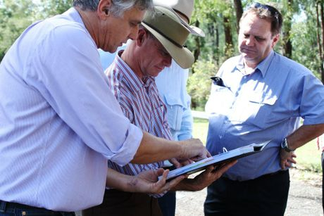 CHRC manager for corporate governance Bill Wilkinson takes Premier Campbell Newman through plans for flood mitigation works at the Nogoa River Rail Bridge. Photo Rebekah Polley / CQ News