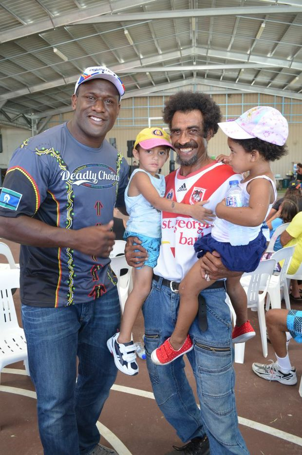 DEADLY FUN: Jeri, Tukana and Tia Kaitani of Bundaberg met rubgy legend Wendell Sailor at the Cultural Healing Day event at WIN Stadium. Photo: Brittany Cook / NewsMail